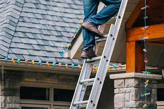 Extension ladder safety when hanging lights